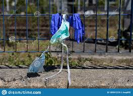 Group Of Used Masks And Gloves Placed By People On A Fence The Waste From Covid19 Stock Photo Image Of Hospital Infection 183541210