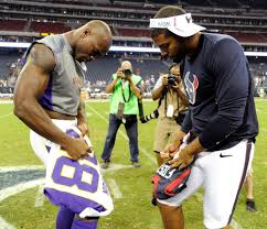 Arian Foster and Adrian Peterson signing and exchanging jerseys. - Imgur