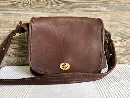 brown leather flap bag legacy trail bag
