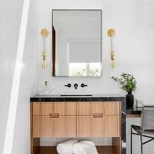 black marble vanity with gold faucet