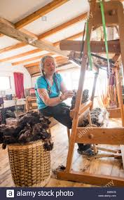 BERYL SMITH, weaver and basket maker, working weaving wool on a ...