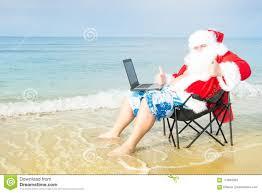 beach working on laptop stock image