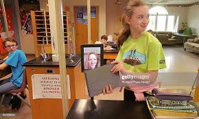 Sierra LaCroix shows Abby Fisher a project on her iPad during a... News  Photo - Getty Images