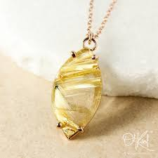 golden rutile quartz leaf necklace raw