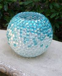 vase out of marbles and a mayo jar