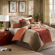 brown and orange comforter rustic