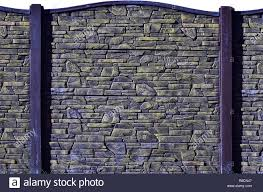 Fence Texture Of Elongated Colored Stones In Warm Colors Weathered Stained Modern Fence Type Colored Relief Concrete Wall Stock Photo Alamy