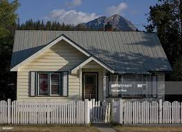 A Small House With A White Picket Fence And A Canadian Flag In The News Photo Getty Images