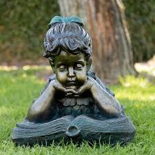 boy reading together garden statue