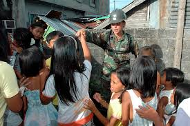 File:US Navy 070630-N-9421C-214 Equipment Operator 3rd Class Tabatha Smith,  attached to Amphibious Construction Battalion (ACB) 1, greets the local  youth after Holy Mass ^ Thanksgiving Ceremony offered by the Barangay  government.jpg -