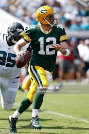 Quarterback Aaron Rogers of the Green Bay Packers is forced out the... News  Photo - Getty Images
