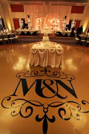 Gold Vinyl Dance Floor With Black Decal Of Bride And Groom S Initials Yanni Wedding Decorations Luxury Wedding Decor Wedding