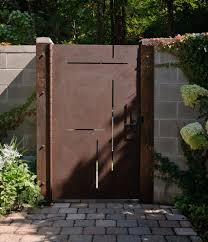Accordion Dog Gates With Contemporary Landscape And Cement Block Cmu Wall Cobblestone Concrete Block Corten Steel Creeping Vine Custom Made Gate Iron Door Laser Cut Metal Gate Modern Design Rust Sculptural Gate