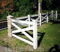Faux Stone Fence Posts Anchor A Wooden X Fence Creating An Attractive Design This One Uses Our Ashford River Rock Faux Fence Design Modern Fence Brick Fence