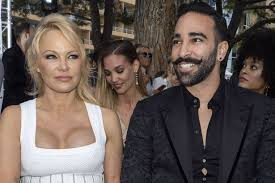 Pamela Anderson's ex Adil Rami 'sacked by Marseille' for skipping training  to mud-wrestle on Fort Boyard - Mirror Online