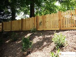 Traditional Picket Fence Design With A Twist We Love The Alternating Picket Height Fences Picket Fence Design Wood Picket Fence Picket Fence