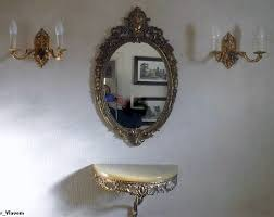 mirror and two wall lamps