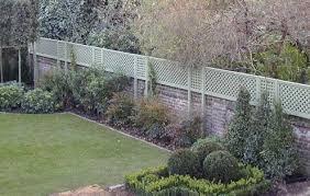 Trellis On A Wall Google Search Garden Trellis Wall Trellis Brick Garden