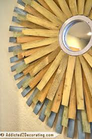 multi colored wood shim sunburst mirror