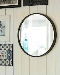 large round wall mirror black metal