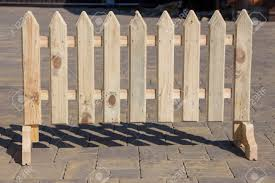 Part Of A Small Wooden Fence With Pegs Close Up Stock Photo Picture And Royalty Free Image Image 107848626