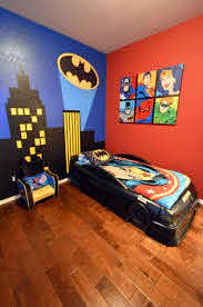 Boy S Batman Superhero Themed Room With Bat Signal Over The City Wall Mural Batmobile Bed And Custom Canvas Themed Kids Room Batman Room Batman Themed Bedroom