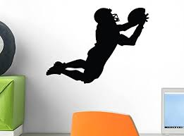 Amazon Com Wallmonkeys Football Silhouette Wall Decal Peel And Stick Graphic 12 In W X 9 In H Wm291857 Home Kitchen