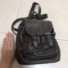 small dark brown faux leather backpack