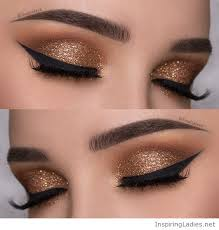 gold eye makeup with black del