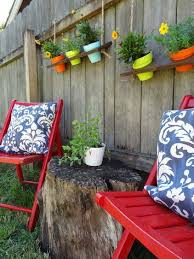 Give Your Backyard Fence A Boost With These Easy Colorful Hanging Shelves Diy Backyard Hanging Shelves Hanging Pots