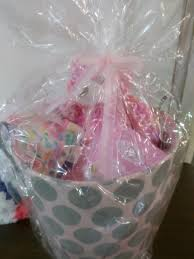 baby gift basket with pink teddy bear