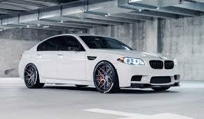 Alpine White Bmw M5 With Tire Stickers