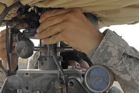 Army Pfc. Dustin Clark adjusts the sights on a radar system at ...