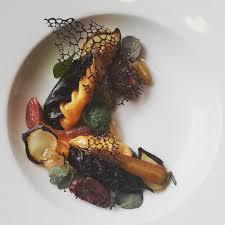 Lobster roe and squid ink culurgiones ...