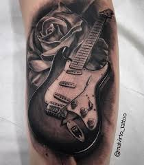 Pin by Adele Jacobs on Needful things | Guitar tattoo design, Guitar  tattoo, Music tattoo designs