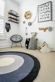 Mini Style Love The Tan Carpet With Navy Rug Over And The White Light Gray Walls With Lots Of Woo Scandinavian Kids Rooms Kids Room Design Kid Room Decor