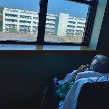 Waves from the rooftop lift spirits of patient battling COVID-19 |  Ascension Via Christi