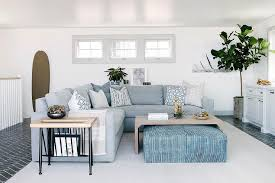 gray slipcovered sofa with blue ottoman