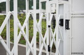 White Stainless Steel Barrier Gate Or Folding Fence Gate For Protection In External Traffic That Blocks The Road Buy This Stock Photo And Explore Similar Images At Adobe Stock Adobe Stock