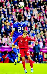 FC Bayern Munich's Philippe Coutinho (down) vies with Benjamin ...