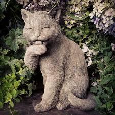 preening cat garden ornament made from