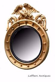 regency round gilt framed convex mirror