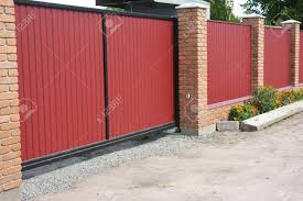 Installing House Red Metal Fence With Garage Gate Of Modern Style Stock Photo Picture And Royalty Free Image Image 99543718