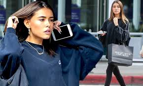 madison beer covers up in an over sized