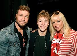 Brian Littrell, his son Baylee Thomas Wylee Littrell and his wife...