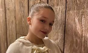 harper beckham looks adorable as she