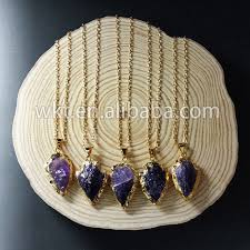 raw crystal necklace with gold trim