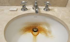 removing rust stains from sinks tubs