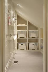 laundry room with sloped ceiling and