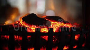 glowing fire in a fireplace side view